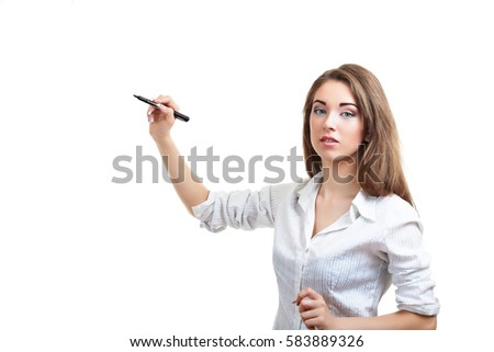 young businesswoman writing with felt-tip pen looking at camera isolated on white background in photostudio