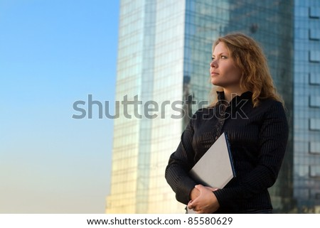Young businesswomen holding laptop. It's her internet business, and she is successful businesswomen - stock photo