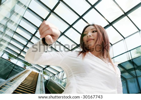 young businesswomen look at her watch - stock photo