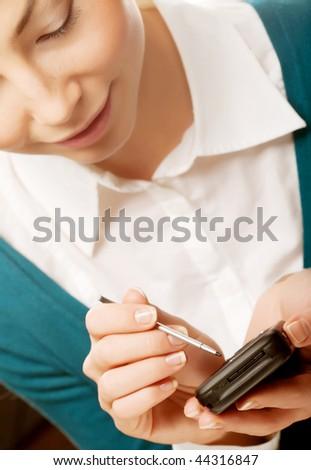 Young businesswomen with PDA.Studio shot. - stock photo