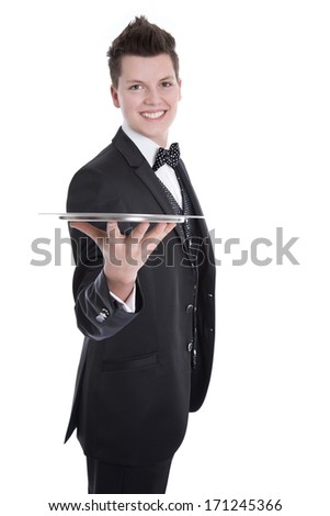 Young butler or waiter in black suit isolated on white - stock photo