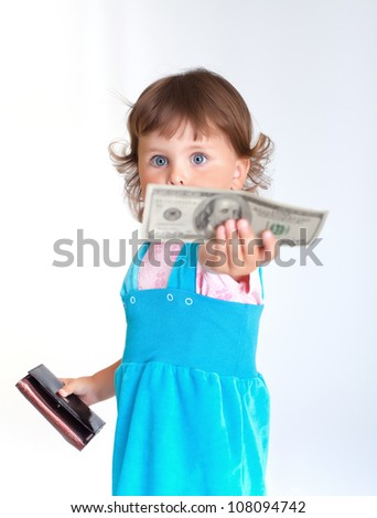 Young buyer. Little girl holds one hundred dollars US - stock photo