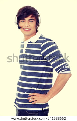 Young call center worker portrait - stock photo
