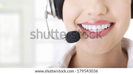 Young call-centre assistant smiling at the camera - stock photo