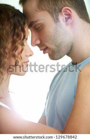 Young calm couple enjoying one another - stock photo