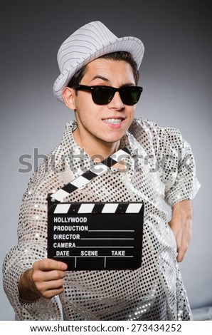 Young camera assistant with clapperboard - stock photo