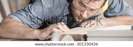 Young carpenter is very neat and precise  - stock photo