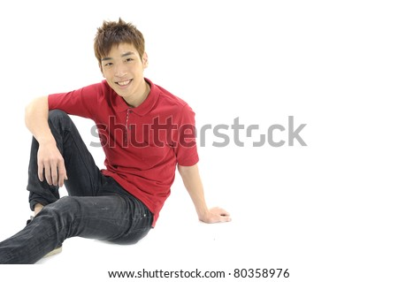 young Casual asian man sitting on the floor - stock photo