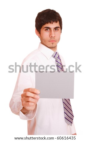 Young casual businessman holding blank poster