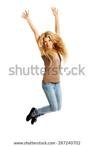 Young casual cheerful student jumping. - stock photo