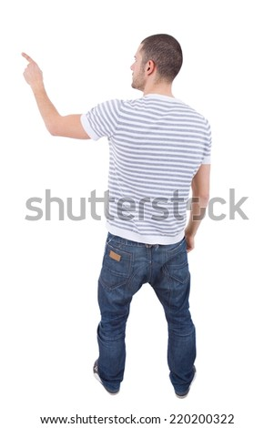 young casual man from the back pointing, full body, isolated - stock photo