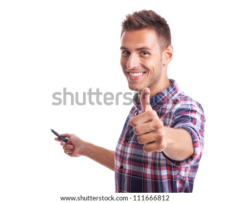young casual man going thumb up and holding a marker on a white background - stock photo