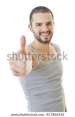 Young casual man going thumbs up, isolated on white background - stock photo