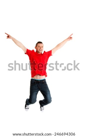 Young casual man jumping in air. - stock photo