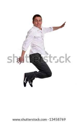 young casual man jumping, isolated in white - stock photo