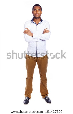 Young casual man looking at camera with arms crossed, isolated over white - stock photo