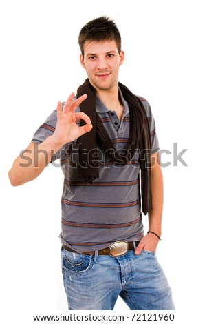 Young casual man making OK sign, isolated on white