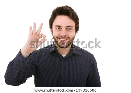 Young casual man making the ok gesture on a white background - stock photo