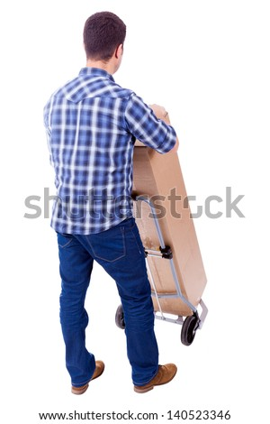 Young casual man moving a boxe with dolly, isolated on white background - stock photo
