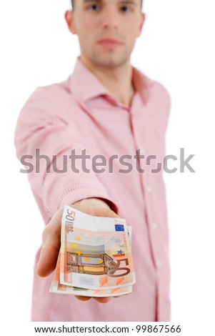 young casual man offering money, focus on the money - stock photo