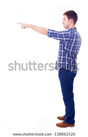 young casual man pointing towards copyspace, isolated on white background - stock photo