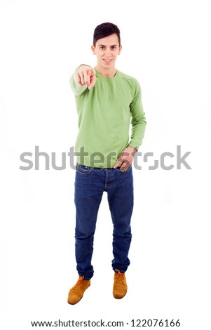 Young casual man pointing with finger at you, isolated on white - stock photo