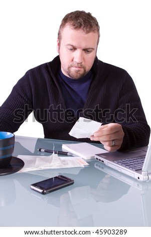 Young  Casual Professional Reviewing Receipts at Work - Isolated Background - stock photo