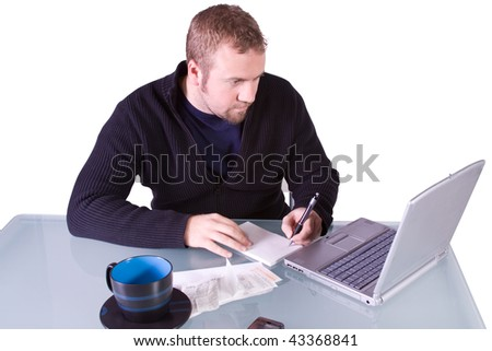 Young Casual Professional Taking Notes at Work - Isolated Background - stock photo