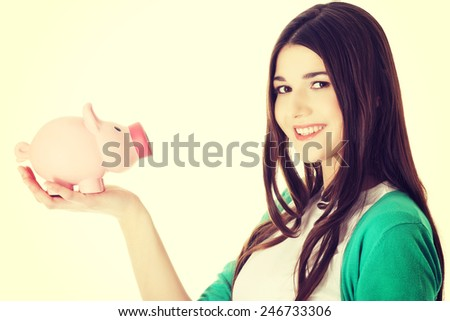 Young casual woman holding piggy-bank. - stock photo