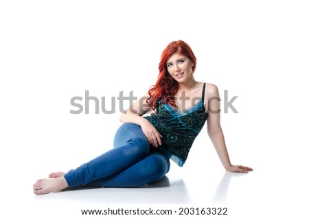 Young casual woman sitting isolated on white background