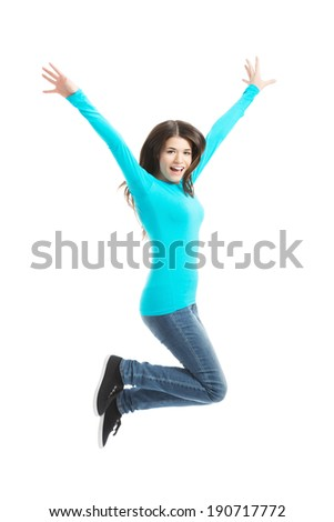 Young casual woman, student jumping. Isolated on white. - stock photo