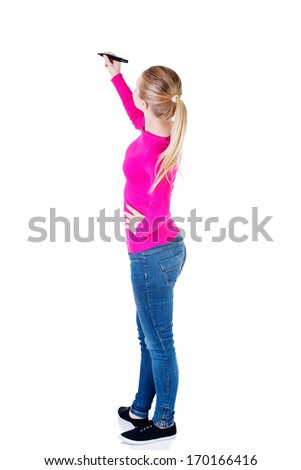 Young casual woman writing on copy space. Back view. Isolated on white. - stock photo