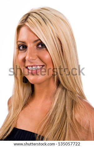 Young Caucasian blonde female facing left of camera with her head turned to the camera and smiling.