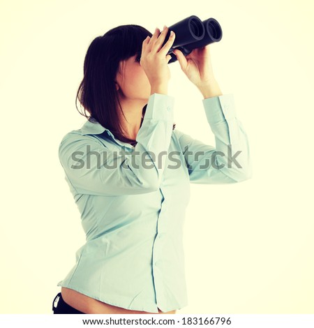 Young caucasian business woman looking throught binocular