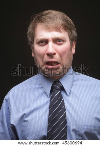 Young caucasian businessman funny shocked upset expression face - stock photo