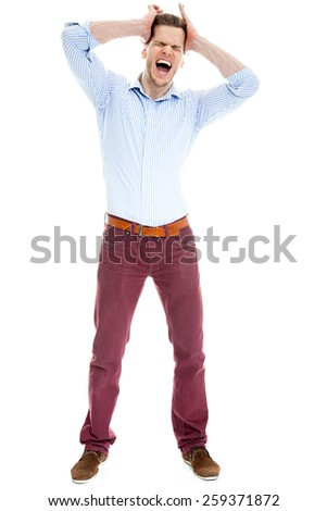 Young caucasian businessman screaming and pulling his hair, isolated on white - stock photo