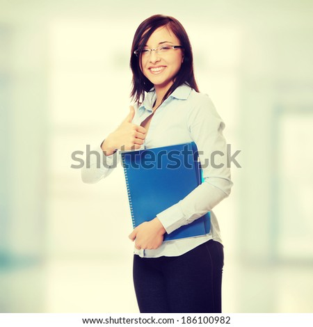 Young caucasian businesswoman gesturing