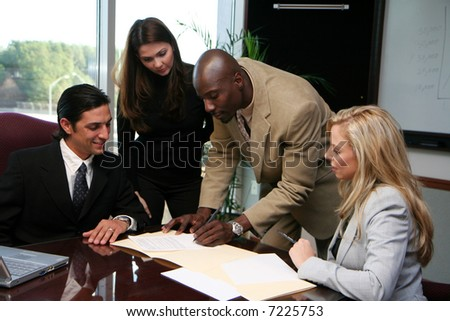 Young caucasian businesswoman with african american man - stock photo