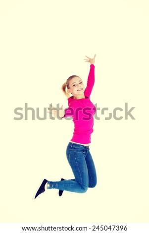 Young caucasian cheerful woman is jumping. - stock photo