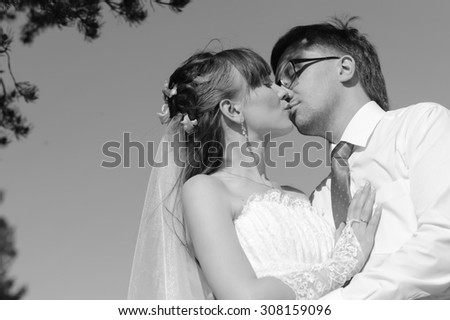 Young caucasian couple wedding portrait in the park