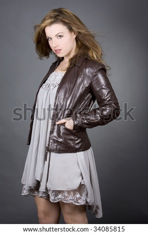 young caucasian fashion model on dark grey background
