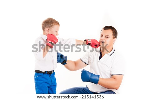 young Caucasian father of boxing with son - stock photo