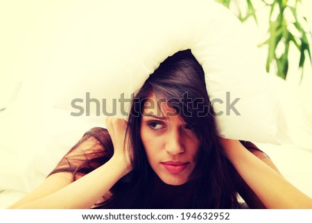 Young caucasian female on bed - stock photo