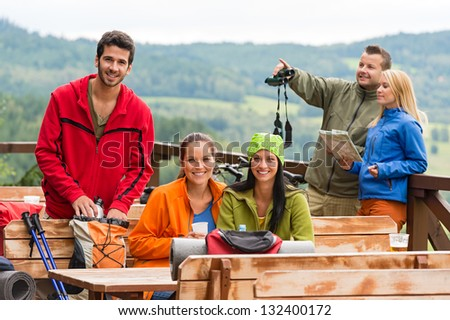 Young caucasian friends relaxing mountain countryside view summer sport - stock photo