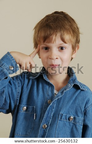 Young Caucasian gesturing boy in blue shirt - stock photo