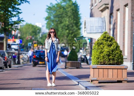Young caucasian girl enjoy european vacation in Amsterdam, Holland - stock photo