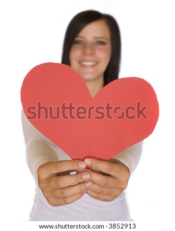 young caucasian girl on a white background smiling holding out a paper heart