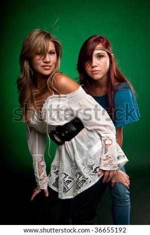 Young caucasian girls enjoying friendship and having fun. - stock photo