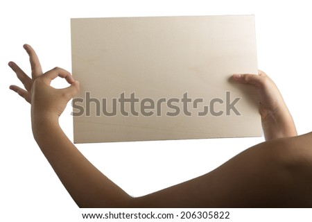 Young caucasian hands holding a light color plywood square blank signboard isolated on white background. All right gesture: left hand making ok.There are no elements to distract viewer from reading  - stock photo