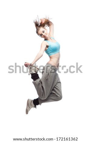 young caucasian hip-hop dancer woman showing some jumps. isolated on white